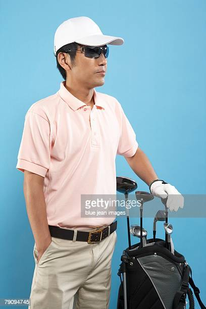 Ready to tee off. A golfer wearing sunglasses.