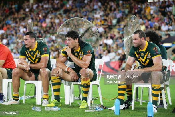 Reagan CampbellGillard Jordan Mclean and Boyd Cordner of Australia take a break on the bench during the 2017 Rugby League World Cup Quarter Final...
