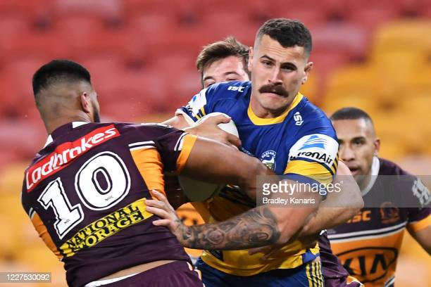 Reagan CampbellGillard of the Eels is tackled during the round three NRL match between the Brisbane Broncos and the Parramatta Eels at Suncorp...