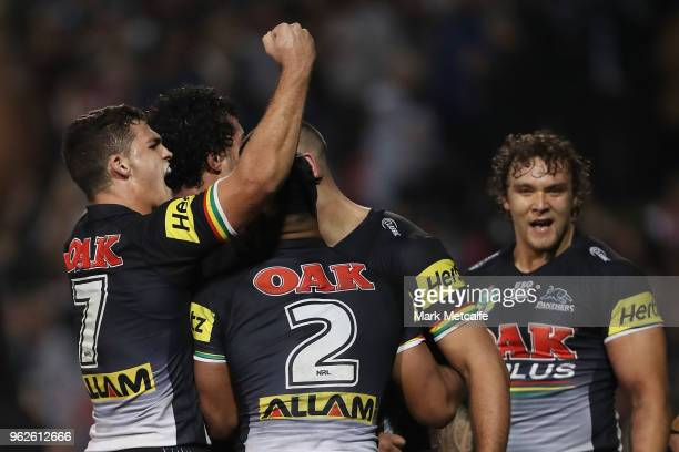 Reagan CampbellGillard of the Panthers celebrates scoring a try with team mate Nathan Cleary of the Panthers during the round 12 NRL match between...