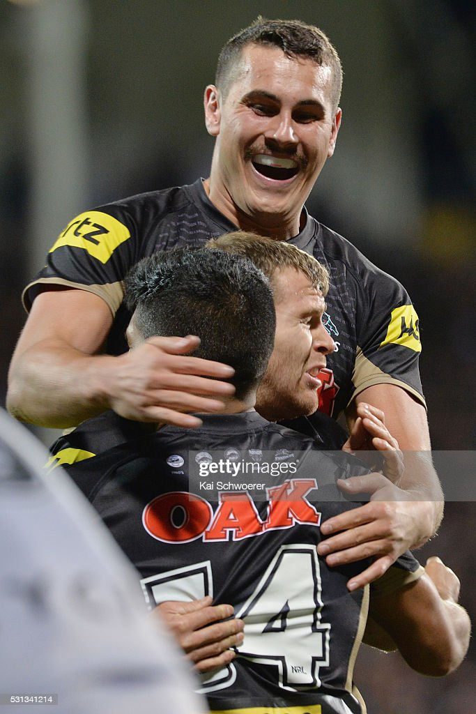 Reagan Campbell-Gillard of the Panthers celebrates with team mates after Tyrone Peachey scores a try during the round 10 NRL match between the Penrith Panthers and the New Zealand Warriors at AMI Stadium on May 14, 2016 in Christchurch, New Zealand.