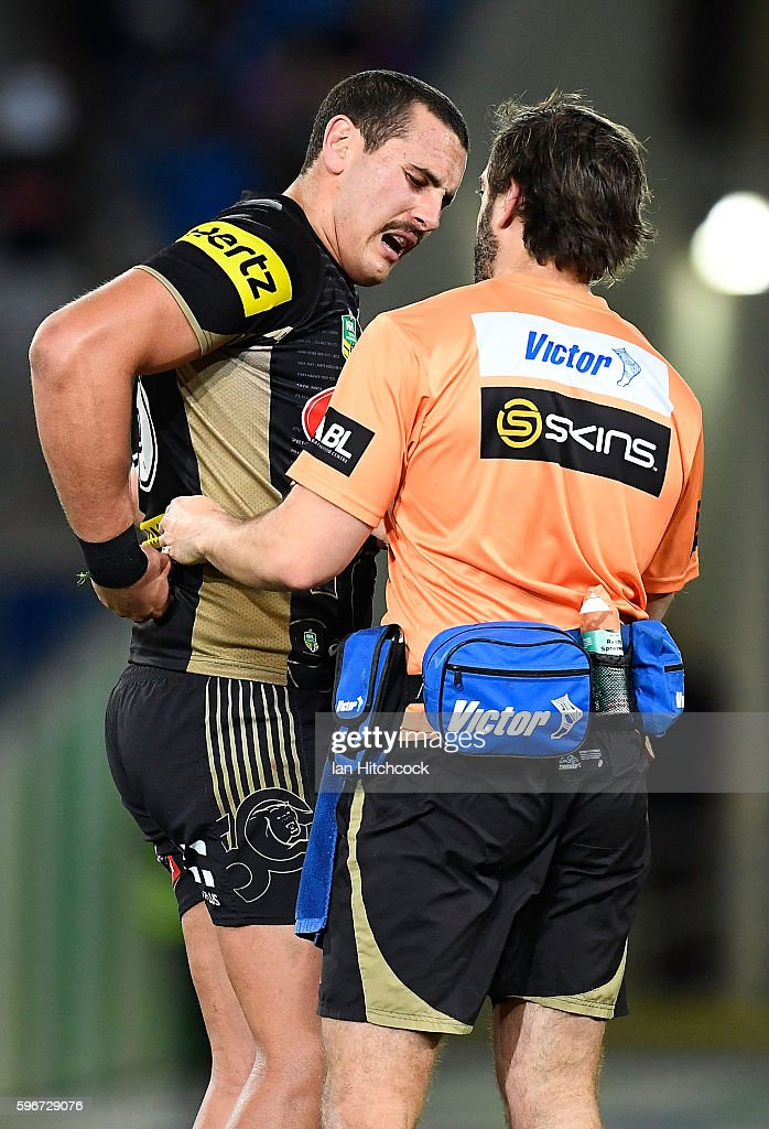 Reagan Campbell-Gillard of the Panthers is seen by a trainer after being injured during the round 25 NRL match between the Gold Coast Titans and the Penrith Panthers at Cbus Super Stadium on August 27, 2016 in Gold Coast, Australia.