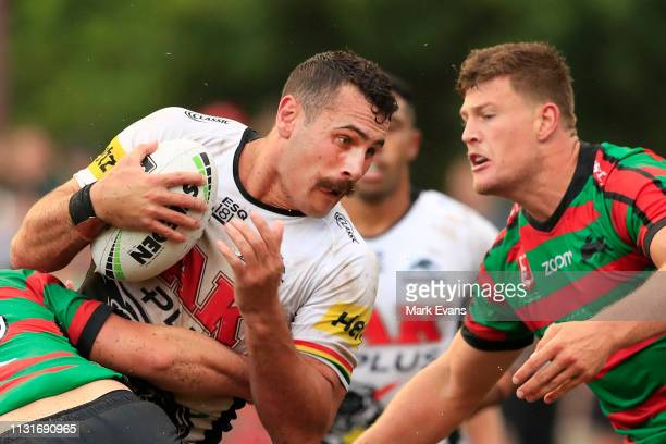 Reagan CampbellGillard of the Panthers is tackled during the NRL trial match between the South Sydney Rabbitohs and the Penrith Panthers at Redfern...