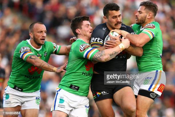 Reagan Campbell-Gillard of the Panthers is tackled during the round 19 NRL match between the Panthers and Raiders at Panthers Stadium on July 28,...
