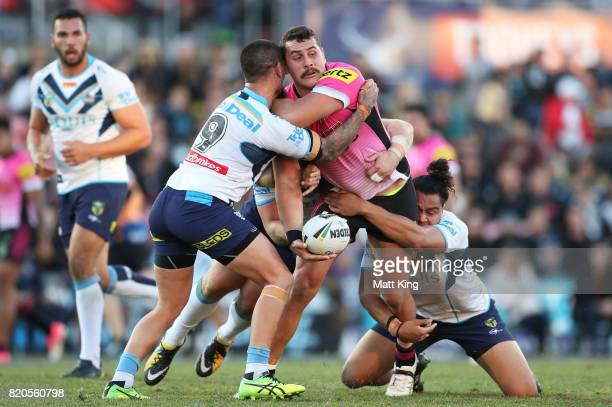 Reagan CampbellGillard of the Panthers is tackled during the round 20 NRL match between the Penrith Panthers and the Gold Coast Titans at Pepper...