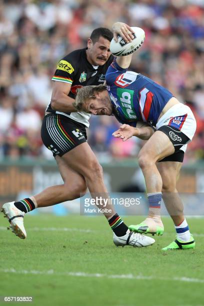 Reagan CampbellGillard of the Panthers tackles Nathan Ross of the Knights during the round four NRL match between the Penrith Panthers and the...