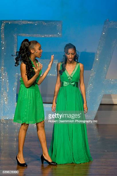Reagan High School Blue Jesters production of Dreamgirls showing high school actresses portraying Lorrell Robinson and Deena Jones in the stage...