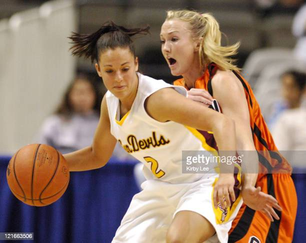 Reagan Pariseau of Arizona State is guarded by Mandy Close of Oregon State during Pacific10 Tournament Quarterfinal at HP Pavilion in San Jose Calif...