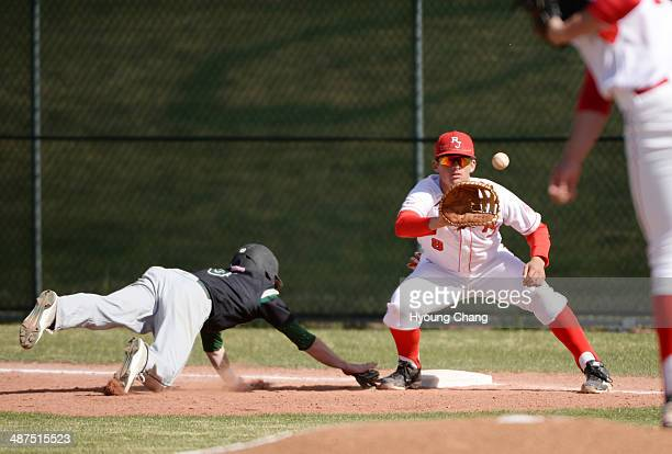 Reagan Todd of Regis Jesuit High School right is trying tag Marc Mumper of Mountain Vista High School in the 1st inning of the game at Regis Jesuit...