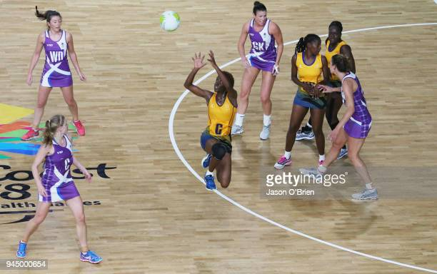 Reah Holder of Barbados catches a pass against Scotland during Netball on day eight of the Gold Coast 2018 Commonwealth Games at Gold Coast...