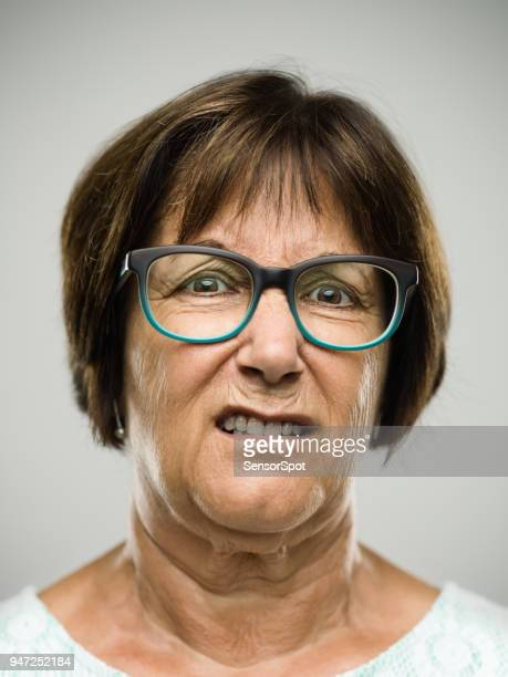real angry senior woman portrait - old lady middle finger stock pictures, royalty-free photos & images
