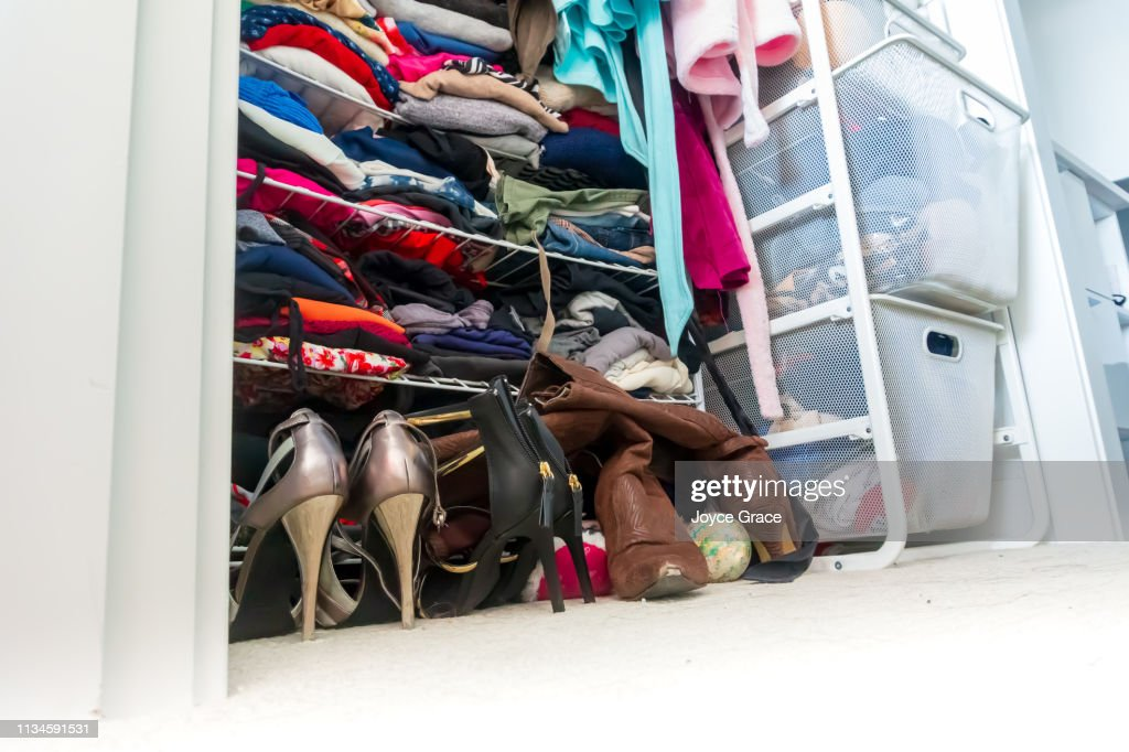 Real apartment closet organized and filled with woman's clothes, depicting shopping, lifestyle habits, real life and clothing choices of a fashionable person. : Stock Photo