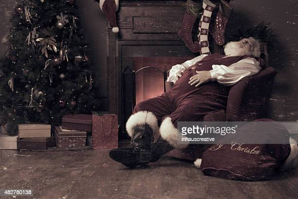 Real authentic photo of Santa Claus asleep.