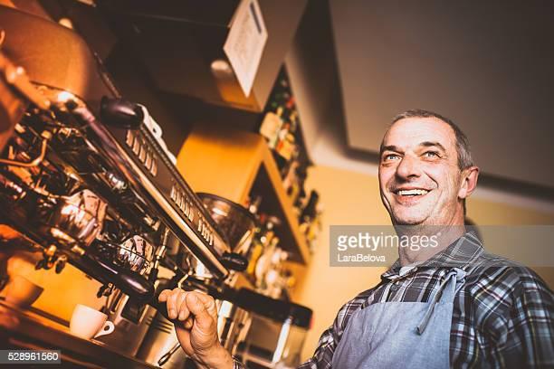 Real barmen at his coffee shop, Italy