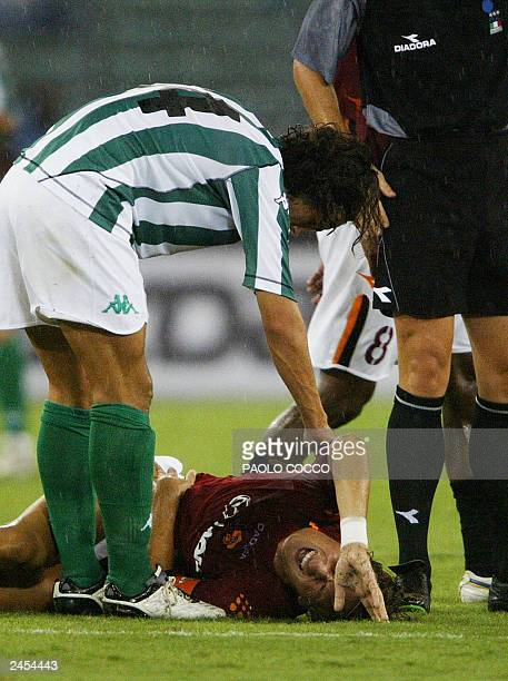 Real Batis' Jesus Prada comforts AS Roma's captain Francesco Totti during their friendly soccer match at Rome's Olympic stadium 25 August 2003 AS...
