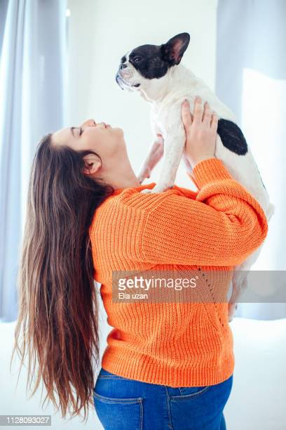 real beauty woman holding a dog - showus stock pictures, royalty-free photos & images