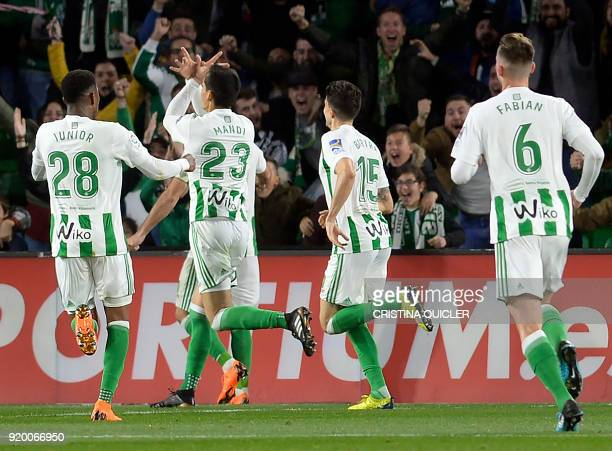Real Betis' Algerian defender Aissa Mandi celebrates scoring a goal during the Spanish league football match Real Betis vs Real Madrid at the Benito...