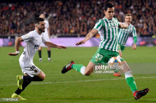 Real Betis' Algerian defender Aissa Mandi vies with Valencia's Spanish defender Jose Luis Gaya Pena during the Spanish Copa del Rey semifinal second...