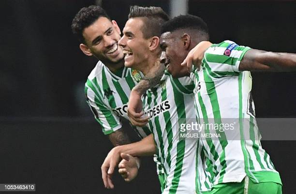 Real Betis' Argentine midfielder Giovani Lo Celso celebrates with Real Betis' Paraguayan forward Arnaldo Sanabria and Real Betis' Dominicans defender...