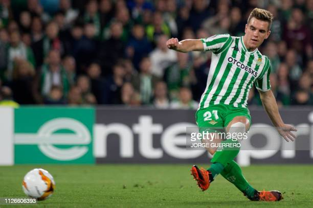 Real Betis' Argentinian midfielder Giovani Lo Celso scores a goal during the UEFA Europa League round of 32 second leg football match between Real...