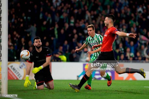 Real Betis' Argentinian midfielder Giovani Lo Celso scores during the UEFA Europa League round of 32 second leg football match between Real Betis and...