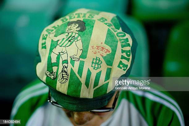 Real Betis Balompie fan with an old club«s soft cap prior to start the La Liga match between Real Betis Balompie and Villarreal CF at Estadio Benito...