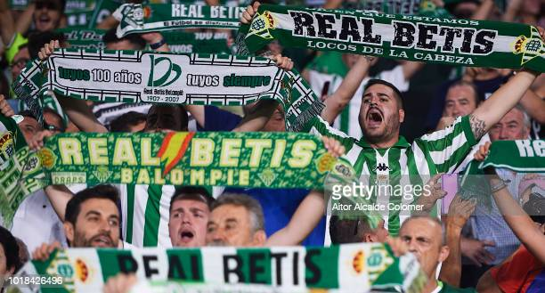 Real Betis Balompie fans cheer their team during the La Liga match between Real Betis Balompie and Levante UD at Estadio Benito Villamarin on August...