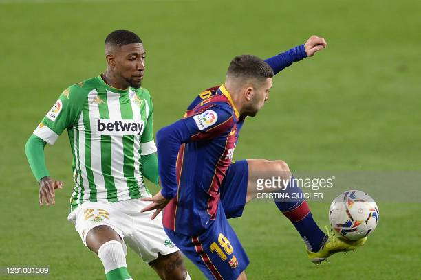 Real Betis' Brazilian defender Emerson Royal challenges Barcelona's Spanish defender Jordi Alba during the Spanish league football match between Real...