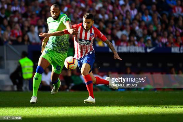 Real Betis' Brazilian defender Sidnei vies with Atletico Madrid's Argentinian forward Angel Correa during the Spanish league football match between...