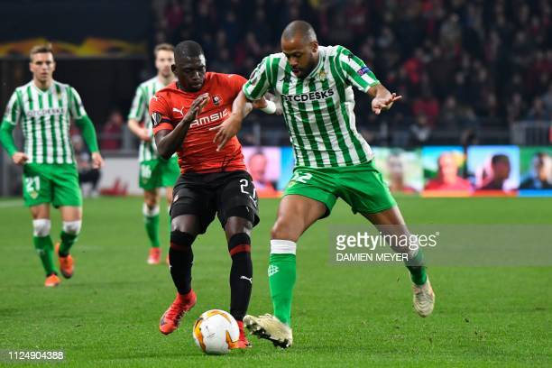Real Betis' Brazilian defender Sidnei vies with Rennes' Malian defender Hamari Traore during during the UEFA Europa League round of 32 firstleg...