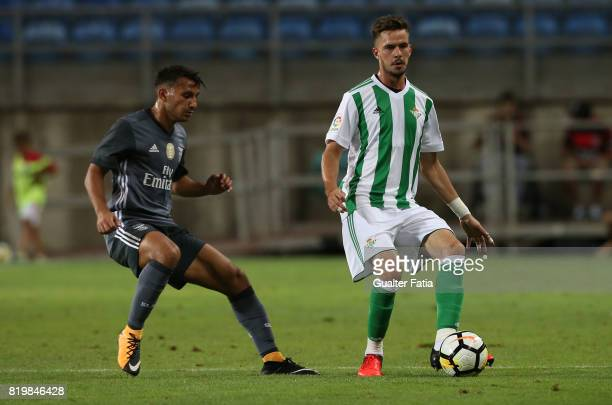 Real Betis defender Jose Carlos with Benfica's midfielder Joao Carvalho from Portugal in action during the Algarve Cup match between SL Benfica and...