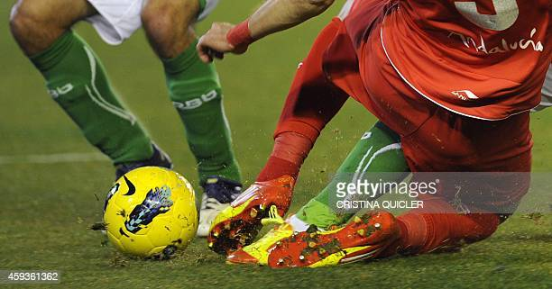 Real Betis' defender Jose Dorado vies with Sevilla's forward Alvaro Negredo and Real Betis' defender Jose Isidoro during their Spanish League...