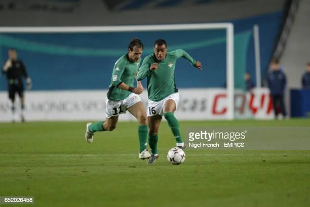Real Betis' Denilson and Alfonso run at the Espanyol defence