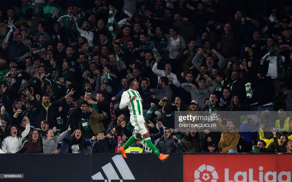 Real Betis' Dominican defender Junior Firpo celebrates a gol during the Spanish Liga football match Real Betis vs Real Madrid at the Benito Villamarin stadium in Sevilla on February 18, 2018. / AFP PHOTO / Cristina Quicler