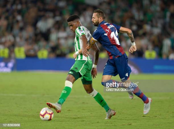 Real Betis' Dominican defender Junior Firpo fights for the ball with Levante's Spanish midfielder Jose Luis Morales during the Spanish league...