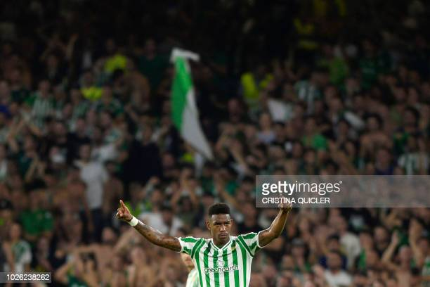 Real Betis' Dominican defender Junior Firpo reacts during the Spanish league football match between Real Betis and Sevilla FC at the Benito...