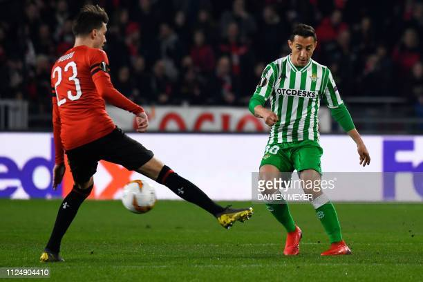 Real Betis' DominicanSpanish midfielder Junior Firpo vies with Rennes' French midfielder Adrien Hunou during the UEFA Europa League round of 32...