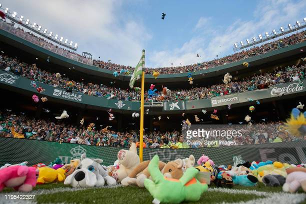 Real Betis fans throw stuffed animals to be collected and given to children in need during the Liga match between Real Betis Balompie and Club...