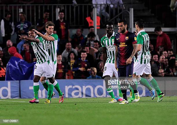 Real Betis' forward Dorlan Pabon celebrates his goal during the Spanish league football match FC Barcelona vs Real Betis at the Camp Nou stadium in...