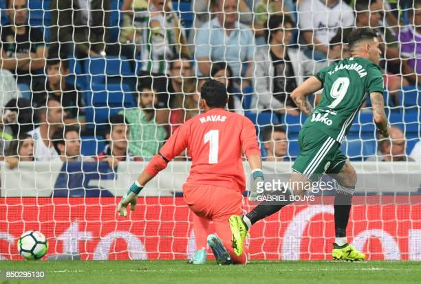 Real Betis' forward from Paraguay Arnaldo Sanabria celebrates beside Real Madrid's goalkeeper from Costa Rica Keylor Navas after scoring a goal...
