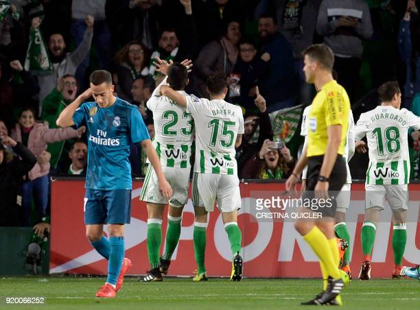 Real Betis' French defender Mandi celebrates scoring a goal during the Spanish league football match Real Betis vs Real Madrid at the Benito...