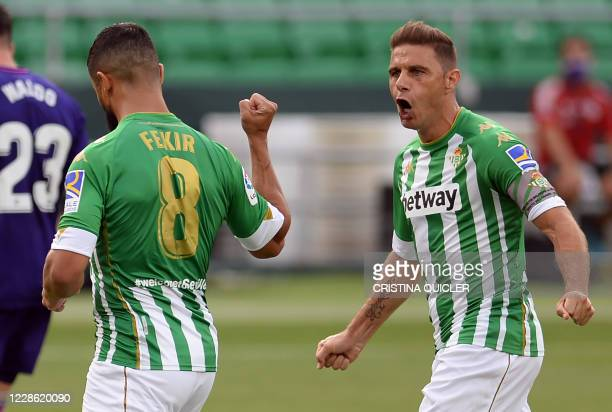 Real Betis' French midfielder Nabil Fekir celebrates his goal with Real Betis' Spanish midfielder Joaquin during the Spanish league football match...
