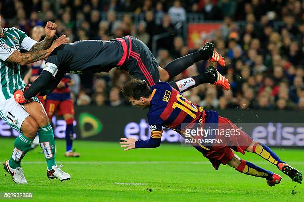 TOPSHOT Real Betis' goalkeeper Antonio Adan hits Barcelona's Argentinian forward Lionel Messi during the Spanish league football match FC Barcelona...