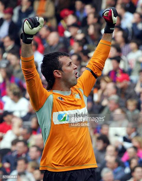 Real Betis goalkeeper Doblas celebrates the second goal against FC Barcelona during their Spanish League football match at the Nou Camp stadium in...