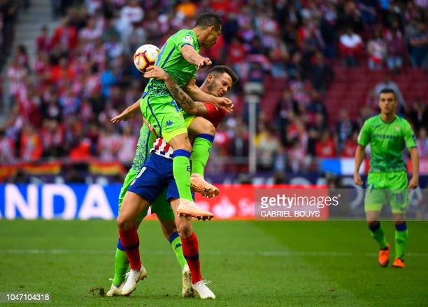 Real Betis' Mexican midfielder Andres Guardado vies with Atletico Madrid's Spanish midfielder Saul Niguez during the Spanish league football match...