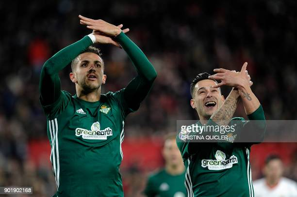 Real Betis' Moroccan defender Zou Feddal celebrates with Real Betis' Spanish forward Sergio Leon Limones after scoring a goal during the Spanish...