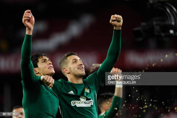 Real Betis' Moroccan defender Zou Feddal celebrates with Real Betis' Algerian defender Aissa Mandi after winning the Spanish league football match...
