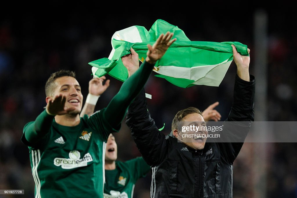 Real Betis' Moroccan defender Zou Feddal (L) celebrates with Real Betis' Spanish midfielder Joaquin (R) at the end of the Spanish league football match between Sevilla and Real Betis at the Sanchez Pizjuan stadium in Sevilla on January 6, 2018. /
