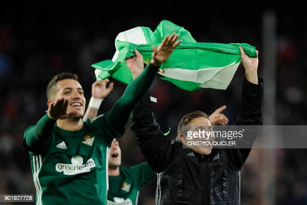 Real Betis' Moroccan defender Zou Feddal celebrates with Real Betis' Spanish midfielder Joaquin at the end of the Spanish league football match...