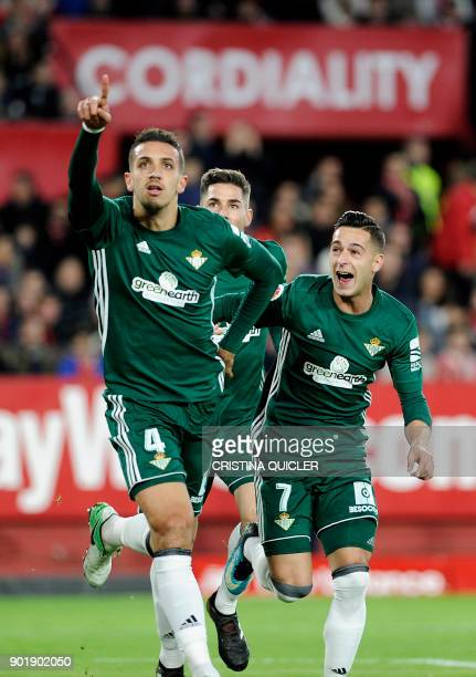 Real Betis' Moroccan defender Zou Feddal celebrates with teammates after scoring a goal during the Spanish league football match between Sevilla and...